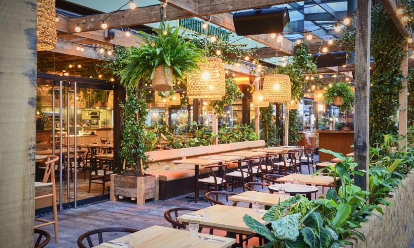 Restaurants surrounded by plants in Spitalfields Market, London
