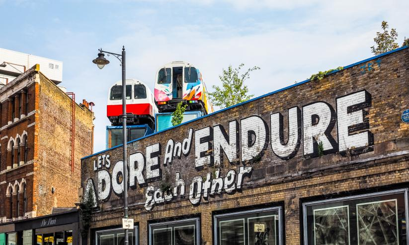 Local street art in Shoreditch, graffiti reads 'Let's adore and endure each other''